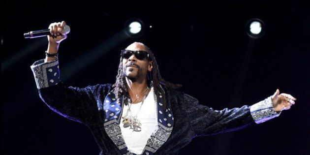 INDIO, CA - APRIL 16: Guest rapper Snoop Dogg perform onstage with rapper Ice Cube during day 2 of the 2016 Coachella Valley Music & Arts Festival Weekend 1 at the Empire Polo Club on April 16, 2016 in Indio, California.  (Photo by Kevin Winter/Getty Images for Coachella)