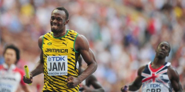 Jamaica's Usain Bolt is all smiles after Jamaica win the Men's 4x100m Relay during day nine of the 2013...