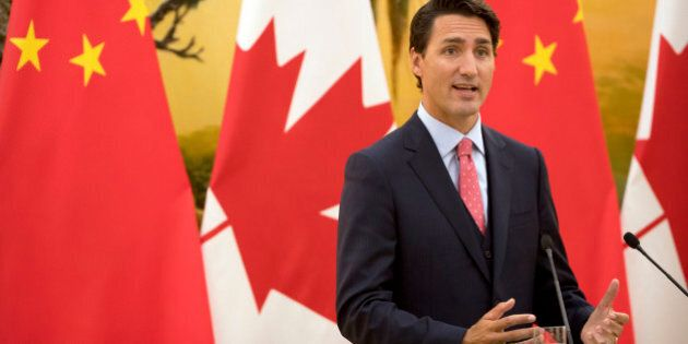 Canada's Prime Minister Justin Trudeau speaks during a joint press conference at the Great Hall of the...
