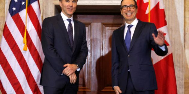 U.S. Secretary of the Treasury Steven Mnuchin (R) waves during a meeting with Canadian Finance Minister William F. Morneau at the Treasury Building in Washington, U.S., March 1, 2017. REUTERS/Joshua Roberts