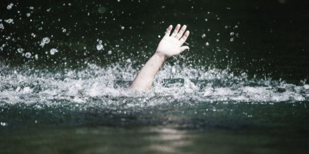 Moving Hand of Someone Drowning and in Need of