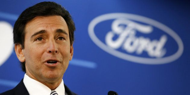 Mark Fields, chief executive officer of Ford Motor Co., speaks during a news conference at the company's...