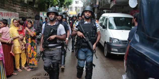 Policemen return from a raid on a building in Dhaka, Bangladesh, Tuesday, July 26, 2016. Police in Bangladesh's...