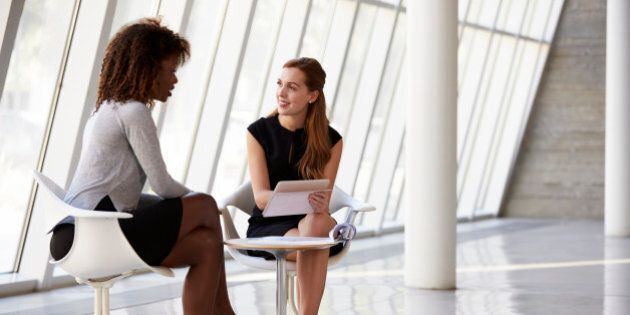 Two Businesswomen Meeting In Reception Of Modern