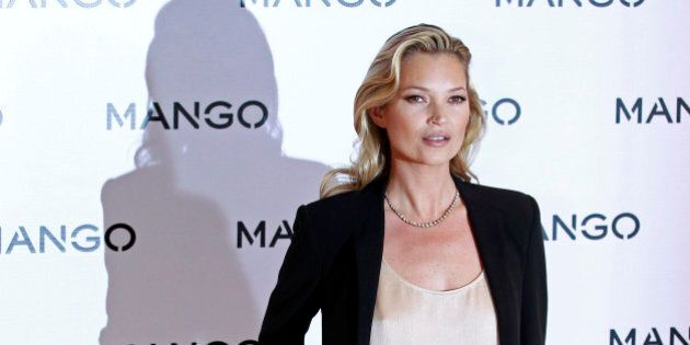 British model Kate Moss poses during the launch of the new Mango 2012 collection in London January 24, 2012.  REUTERS/Stefan Wermuth (BRITAIN - Tags: ENTERTAINMENT BUSINESS)