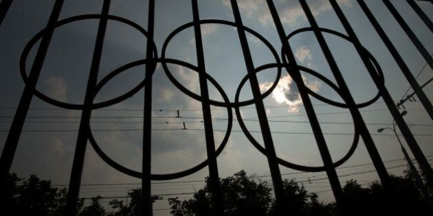 The Olympics rings are seen on a fence in front of the Russian Olympic Committee building in Moscow,...