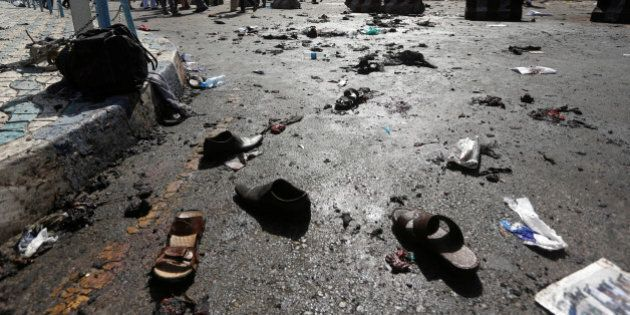 The shoes of victims are seen at the site of blast in Kabul, Afghanistan July 23, 2016.REUTERS/Omar