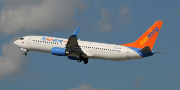 'Fort Lauderdale, USA - January 11, 2009: Sunwing Boeing 737 passenger jet departs Fort Lauderdale back...