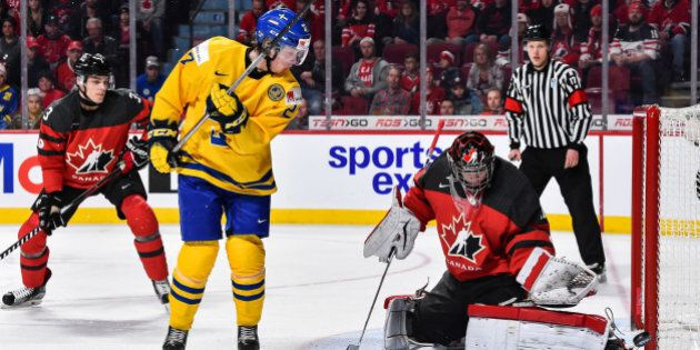 MONTREAL, QC - JANUARY 04: Goaltender Carter Hart #31 of Team Canada makes a pad save on Jonathan Dahlen...