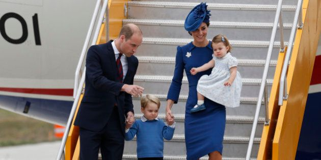 Britain's Prince William (L), Catherine, Duchess of Cambridge, Prince George (2nd L) and Princess Charlotte...