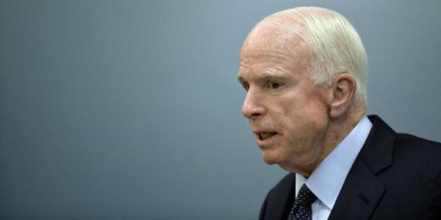 US Republican Senator for Arizona John McCain delivers a message to the media at the Benjamin Franklin...