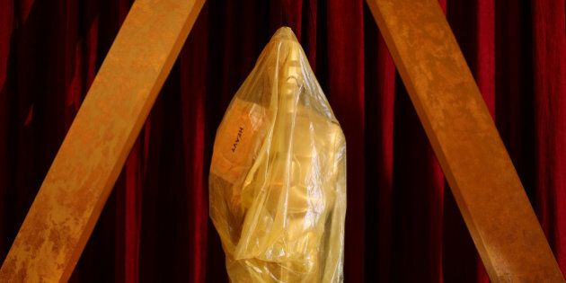 An Oscar statue sits wrapped in plastic along the red carpet as preparations continue for the 89th Academy...