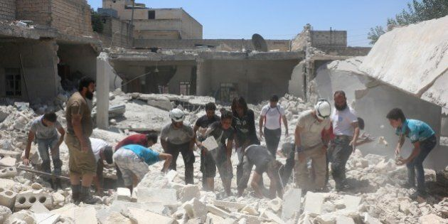 ALEPPO, SYRIA - JULY 24: Civil defense team members inspect the debris after the war-crafts belonging...