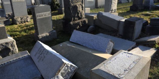 Vandalized tombstones are seen at the Jewish Mount Carmel Cemetery, February 26, 2017, in Philadelphia,...