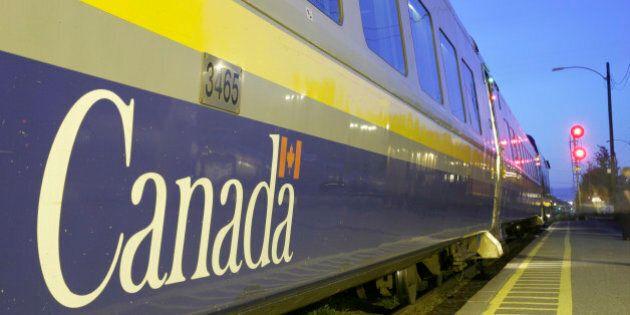 Canada, Charny, VIA Rail train station passenger car platform in the evening