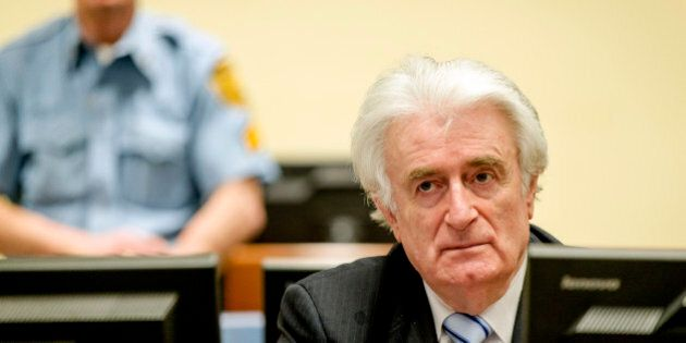 Ex-Bosnian Serb leader Radovan Karadzic sits in the court of the International Criminal Tribunal for...