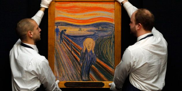 Sotheby's employees pose for a photograph with Edvard Munch's