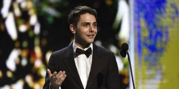 French Canadian actor and film director Xavier Dolan speaks after winning the Best Editing award for...