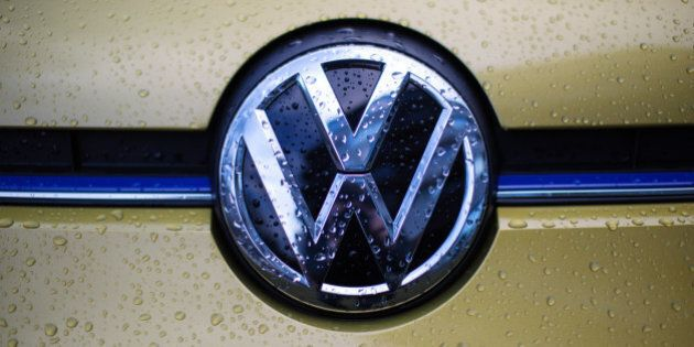 LONDON, ENGLAND - FEBRUARY 23: The VW logo is displayed on a Volkswagen e-Up electric car during a photocall...