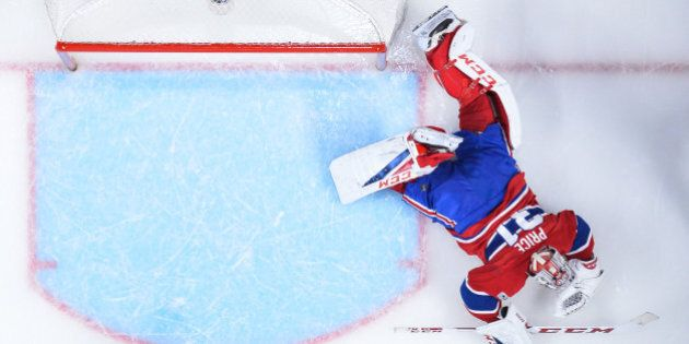 MONTREAL, QC - APRIL 20: Goaltender Carey Price #31 of the Montreal Canadiens lays on the ice after allowing...