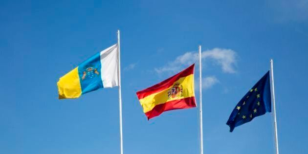 Flags of the European Union, Spain and Canary Islands flying at the airport, Lanzarote, Canary islands,...