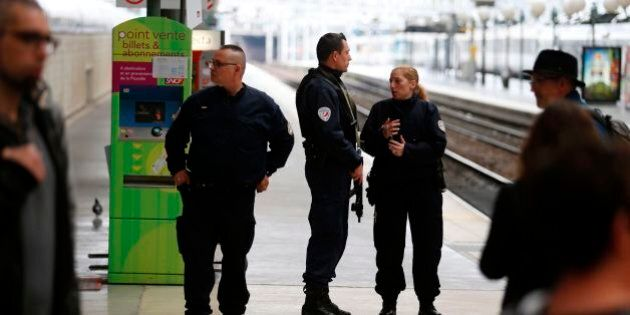 French policemen stand guard on a platform at the Gare du Nord train station in Paris on April 22, 2017,...