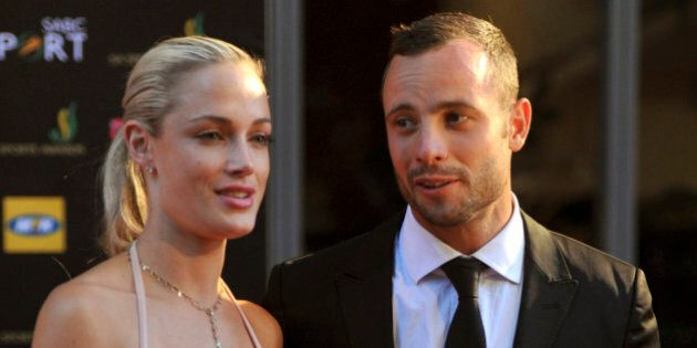 FILE - In this Nov. 4, 2012 file photo, South African Olympic athlete Oscar Pistorius and Reeva Steenkamp...