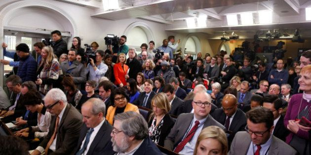 Journalists wait for U.S. President Barack Obama to start his annual year-end news conference at the...