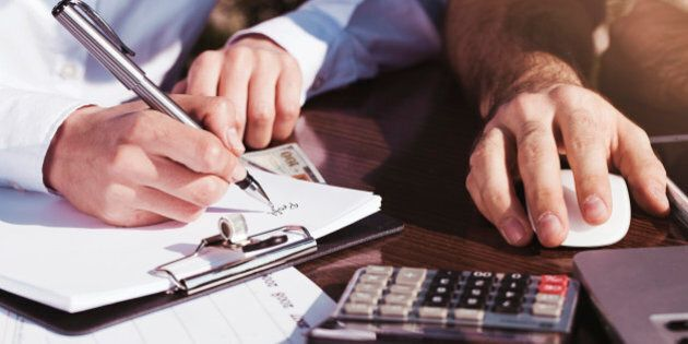 Office, business tools with dollars and calculator on