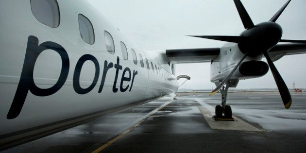 A Porter Airlines Inc. Q400 plane stands on the tarmac at Billy Bishop Toronto City Airport in Toronto,...