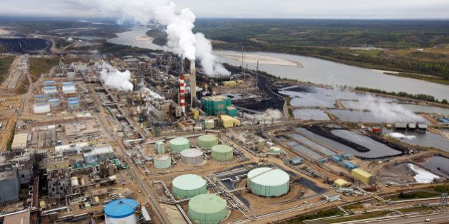The Suncor tar sands processing plant near the Athabasca River at their mining operations near Fort McMurray,...