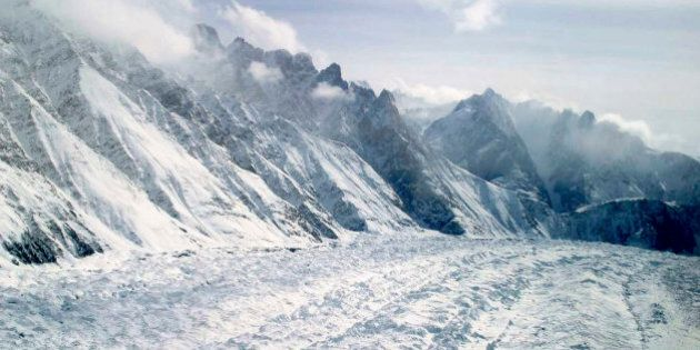 FILE -  This Feb. 1, 2005 file photo shows an aerial view of the Siachen Glacier, which traverses the Himalayan region dividing India and Pakistan, about 750 kilometers (469 miles) northwest of Jammu, India. An avalanche hit the Siachen Glacier in the Indian-controlled portion of Kashmir early Wednesday,Feb.3, 2016 trapping 10 Indian army soldiers in the snow. (AP Photo/Channi Anand, File)