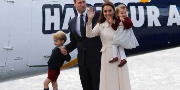 Britain's Prince William, Catherine, Duchess of Cambridge, Prince George and Princess Charlotte board...