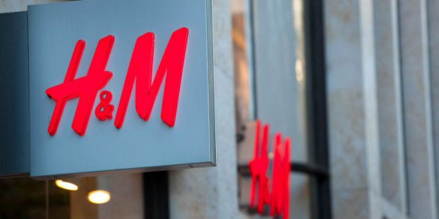 A H&M logo sits on display outside a fashion clothing store operated by Hennes & Mauritz AB in Dusseldorf,...