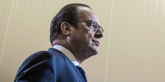 French President Francois Hollande pauses as he delivers a speech as he inaugurates the new organic food...