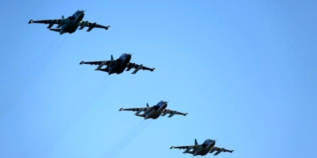 Russian Su-25 ground attack jets prepare to land after return from Syria at a Russian air base in Primorsko-Akhtarsk,...