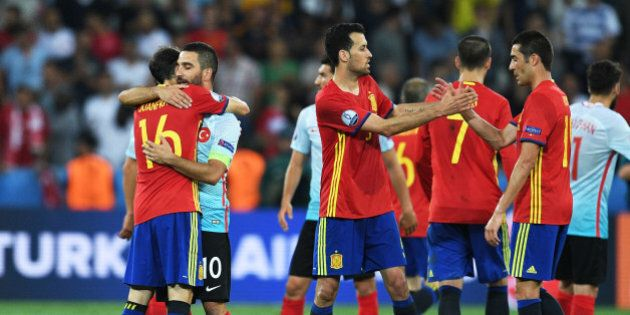 NICE, FRANCE - JUNE 17: Juanfran of Spain and Arda Turan of Turkey share a hug at full time of the UEFA...