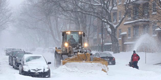 A snowplow clears the street during a snowstorm in Quebec City, December 15, 2013. Between 15 and 30cm...