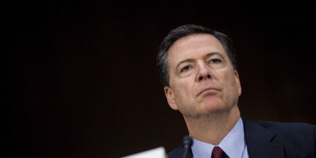 James Comey, director of the Federal Bureau of Investigation (FBI), listens to testimony during the Senate...