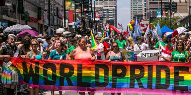 TORONTO, CANADA - JUNE 29: More than 50,000 people line Yonge Street in downtown to view the World Pride...