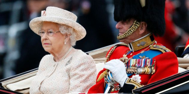 Britain's Queen Elizabeth and Prince Philip return to Buckingham Palace by carriage after attending the...