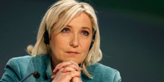 France's far-right National Front political party leader Marine Le Pen looks on during a news conference...