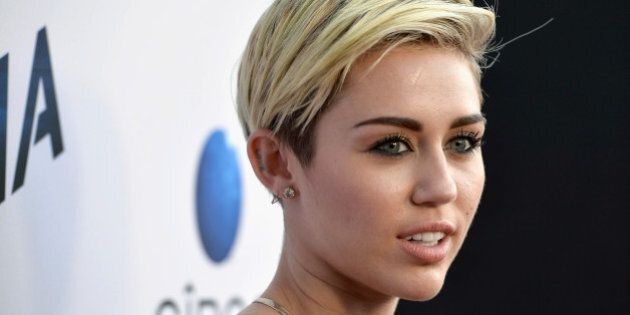 LOS ANGELES, CA - AUGUST 08: Singer Miley Cyrus attends the premiere of Relativity Media's 'Paranoia'...