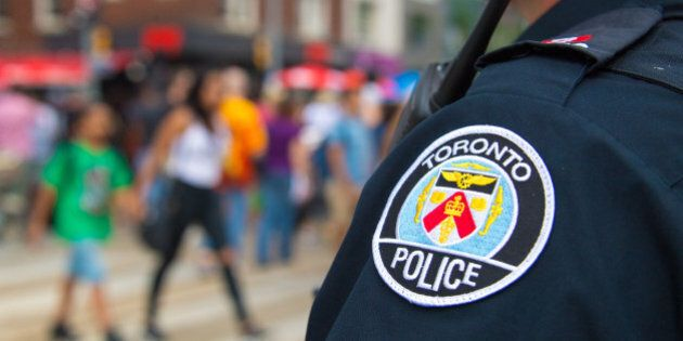 TORONTO, ONTARIO, CANADA - 2016/07/09: Salsa on Saint Clair Avenue West: Toronto Police serving and protecting...