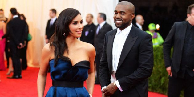 NEW YORK, NY - MAY 05: Kim Kardashian (L) and Kanye West attend the 'Charles James: Beyond Fashion' Costume Institute Gala at the Metropolitan Museum of Art on May 5, 2014 in New York City.  (Photo by Mike Coppola/Getty Images)