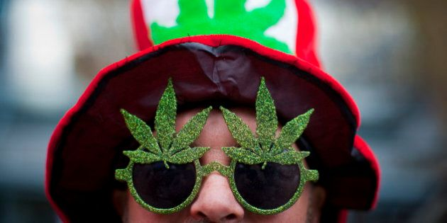 A man, wearing a marijuana-themed hat and sunglasses, is pictured at the Vancouver Art Gallery during...