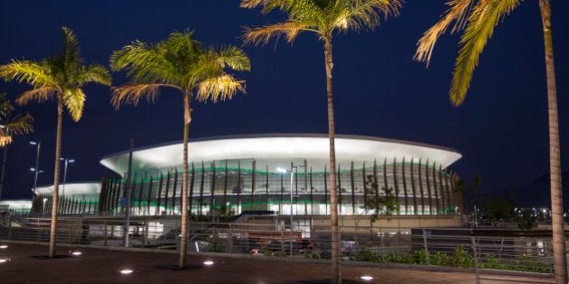 The Carioca Arena 1 is seen behind palm trees at the Rio 2016 Olympic Park in Rio de Janeiro, Brazil,...