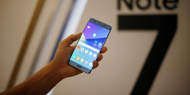 A model poses for photographs with a Galaxy Note 7 new smartphone during its launching ceremony in Seoul,...