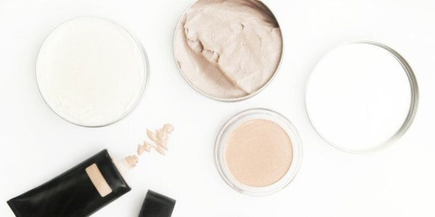 Top view of different cosmetics products on the white
