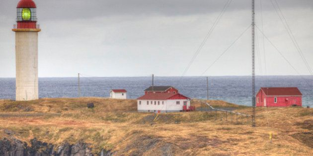 The Cape Race lighthouse towers over surrounding buildings. It played a major role in relaying news of the 'Titanic.'